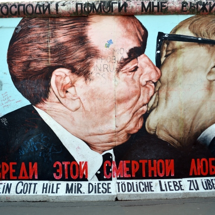 Leonid Brezhnev and Erich Honecker in a fraternal embrace.